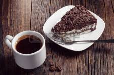36922819-cup-of-hot-coffee-and-chocolate-cake-on-dark-wooden-table